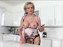 Lady Sonia rubs dildo with tits